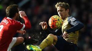 juan-mata-of-manchester-united-challenges-nacho-monreal-of-arsenal-picture-id512850632