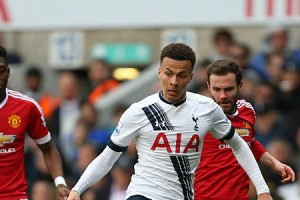 dele-alli-of-tottenham-hotspur-is-surrounded-by-manchester-united-picture-id520255978